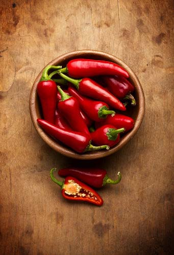 Picture of red serrano peppers which contain natural compounds to help burn fat