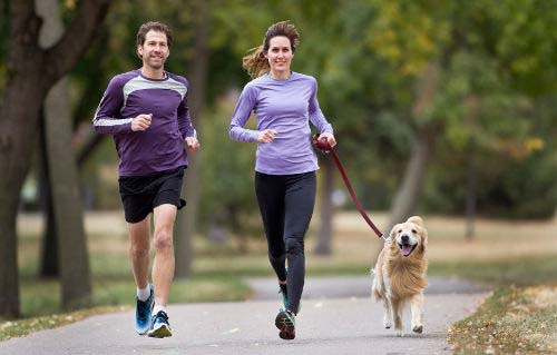 Couple exercising with their dog which is a great way to lose weight