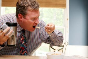 Businessman Eating Oatmeal for Breakfast