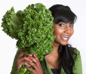 Woman with Bunch of Mustard Greens