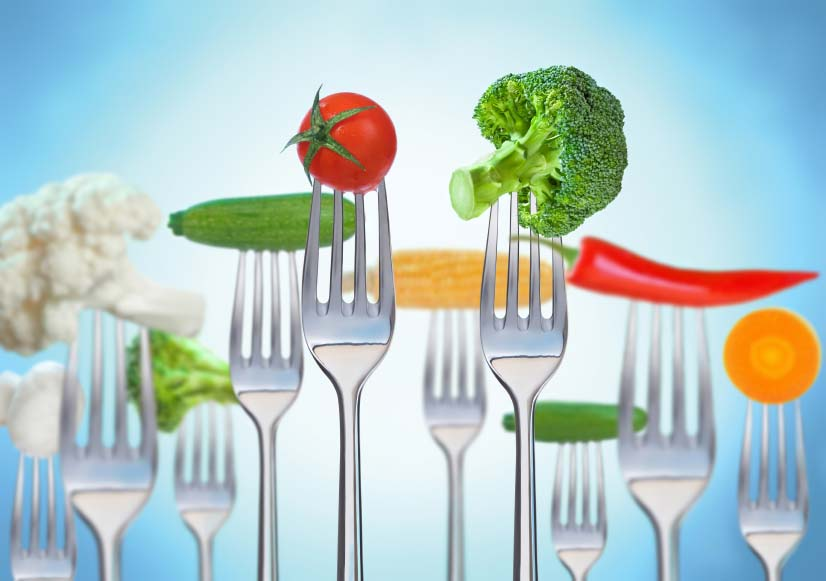 Row of Forks with Raw Vegetables