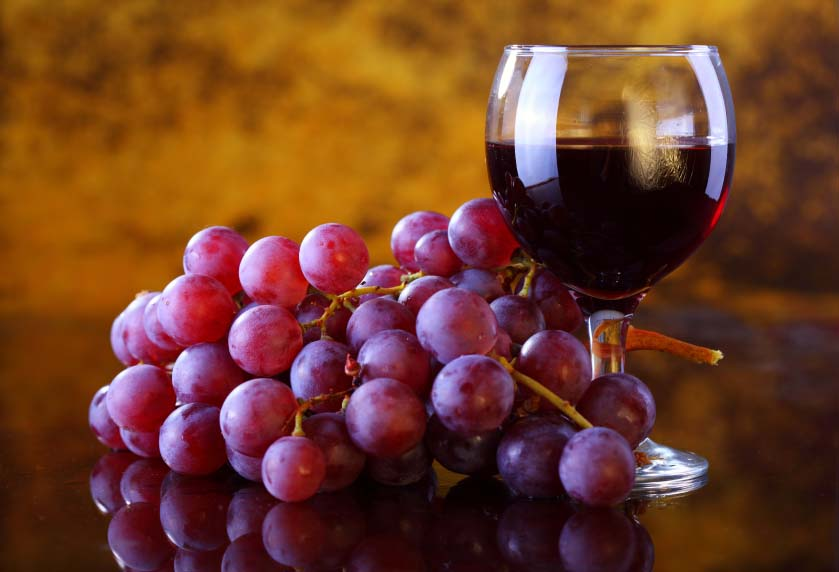 Glass of Red Wine and Bunch of Red Grapes