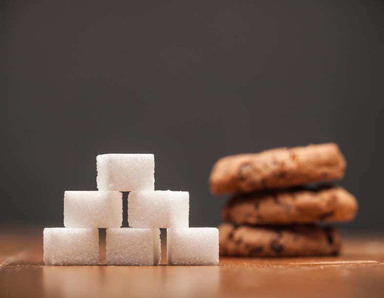 Stack of Sugar Cubes with Cookies