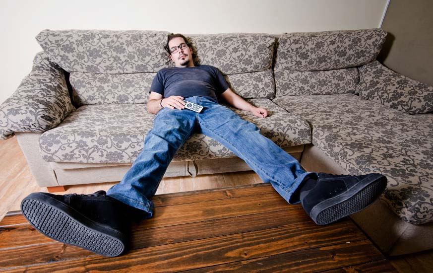 Man Sleeping on Sofa During the Day