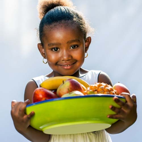 Child with Bowl of Healthy Snacks