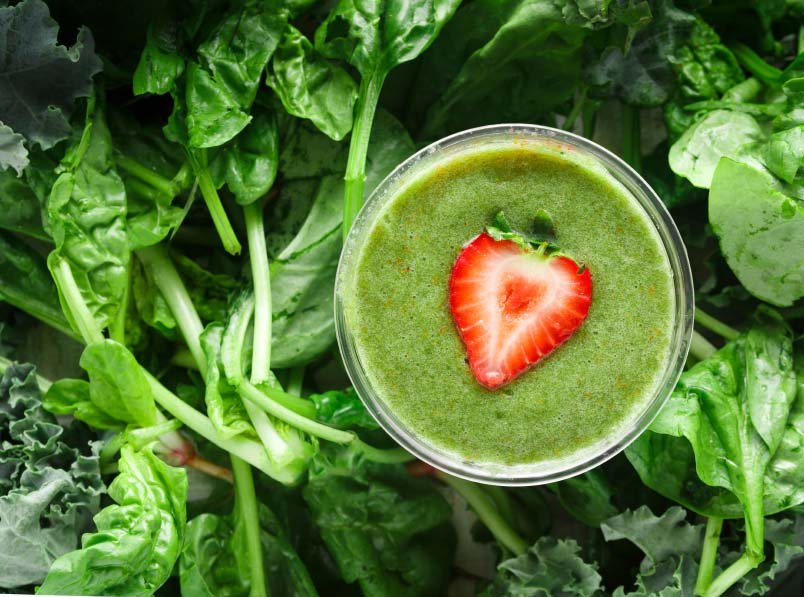 Green Smoothie with a Slice of Strawberry
