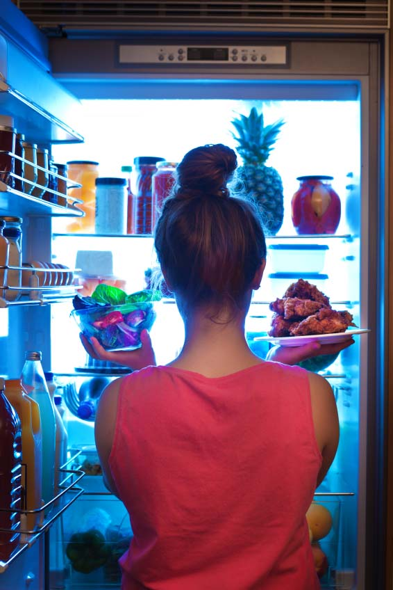 Woman Starring Into Refrigerator Late at Night