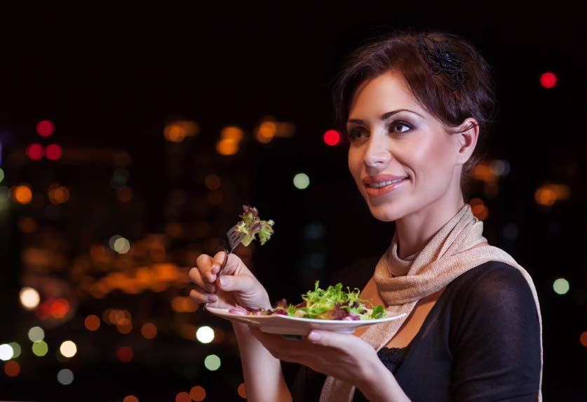 Woman Eating Salad for Dinner