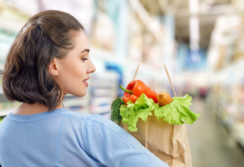 Woman with Bag of Healthy Groceries