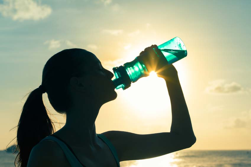 Woman Drinking Large Bottle of Water