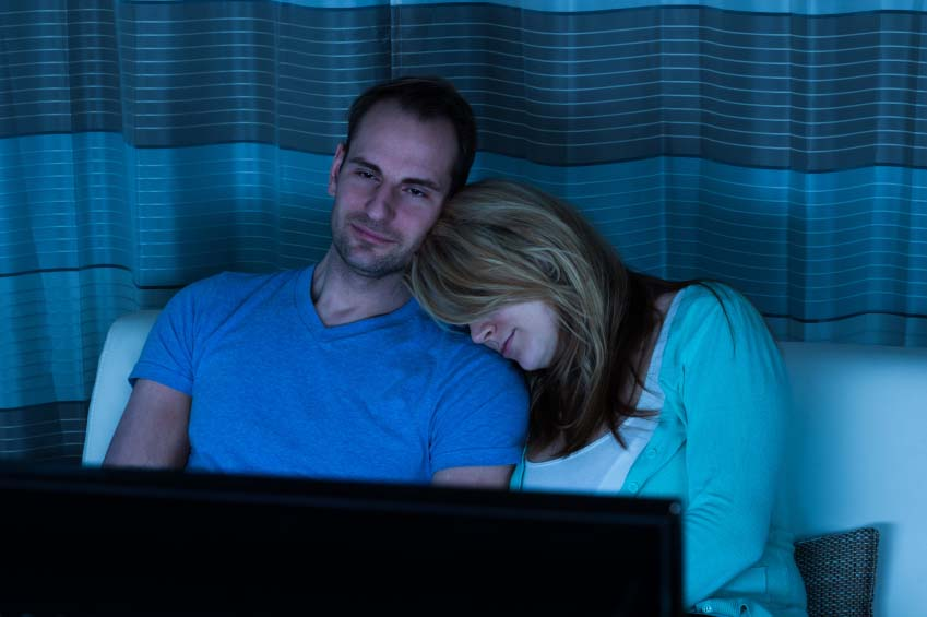Couple Watching TV in Bed