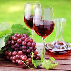Glasses of Red Wine and Bunch of Grapes