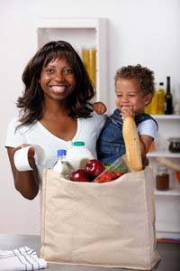 Mom with Child Looking at Grocery Ticket