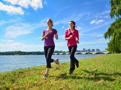 Two Women Running Next to River
