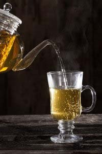 Pouring a Glass of Chamomile Tea