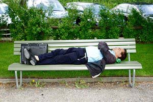 Man Napping on Park Bench