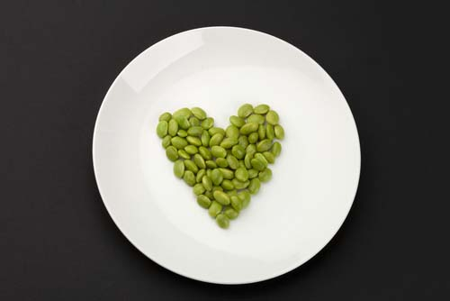 Heart Shape of Soybeans on White Plate