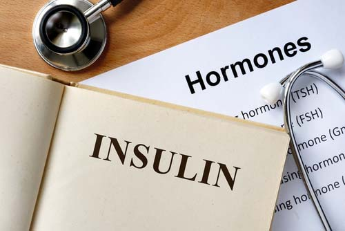 Insulin Book Laying on Hormones Chart