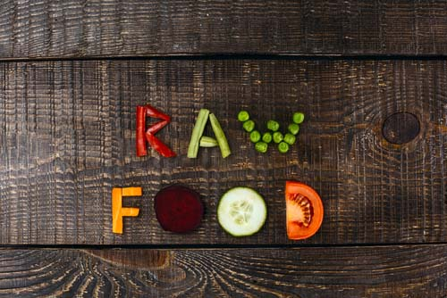 Sign with Raw Food Spelled with Veggies