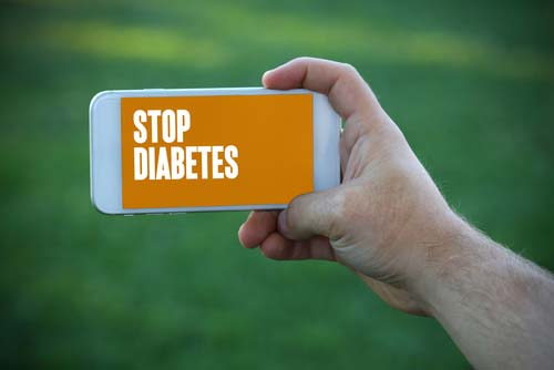 Smartphone with Stop Diabetes Displayed