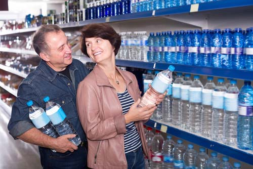 Couple Buying Water in Grocery Store