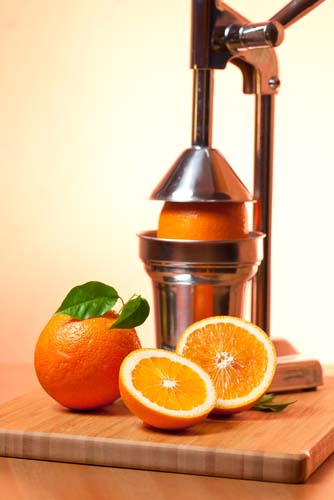 Manual Juicer with Oranges
